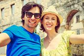 stock photo of arena  - Tourist Couple Taking Selfie in Ancient Arena - JPG
