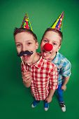 stock photo of moustache  - Hilarious twins with clown nose and moustache during fool - JPG