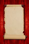 picture of vintage antique book  - Vintage blank aged paper scroll on red wooden background with copy space - JPG