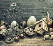 picture of nostalgic  - Vintage easter decoration with eggs birdhouse and birdcage - JPG