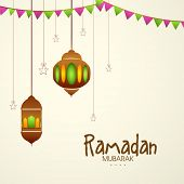 pic of ramazan mubarak  - Hanging traditional lanterns on beige background for or Islamic holy month of prayers - JPG
