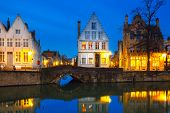 image of medieval  - Scenic city view of Bruges canal with beautiful medieval colored houses and reflections - JPG