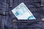 stock photo of brazilian money  - 100 Brazilian Reais on the jeans pocket - JPG
