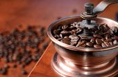 picture of spit-roast  - Freshly roasted coffee beans in the mill - JPG