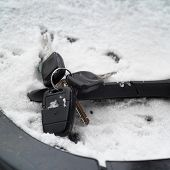 image of wiper  - Forgotten ignition keys on a windscreen wiper concept of driving in a bad weather conditions - JPG