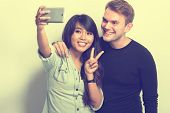 pic of multicultural  - A portrait of Happy Young Multiculture Couple - JPG