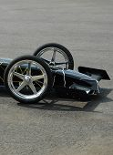 stock photo of dragster  - Front end of slow moving drag car - JPG