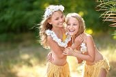 picture of sisters  - portrait of two sisters twins in tropical style - JPG