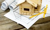 Many drawings for building and small house on old wooden background. poster