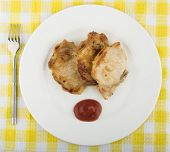 stock photo of pork cutlet  - Fried pork cutlet tomato sauce in plate on tablecloth - JPG