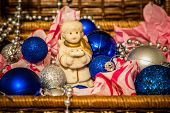 picture of christmas angel  - Christmas decoration with balloons in the box on warm background with pretty little angel - JPG