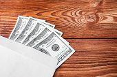 stock photo of one hundred dollar bill  - five hundred dollars out of one hundred dollar bills in an envelope - JPG