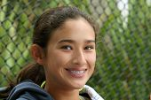foto of puberty  - happy teen girl with braces - JPG