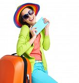 picture of boarding pass  - Portrait of female tourist with travel suitcase and blue boarding pass - JPG
