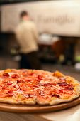 pic of take out pizza  - tasty hot pizza on the white wooden table - JPG