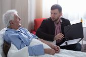 stock photo of deceased  - Terminal patient talking with notary about his last will - JPG
