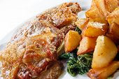 image of veal  - Veal a la Romana served with diced fried potato and boiled spinach - JPG