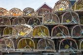 stock photo of trap  - Stacks of wooden lobster traps in North Rustico - JPG