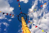 pic of flag pole  - Flags on the rope to the wheel on a pole in the sky at the fair - JPG
