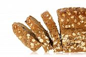 stock photo of whole-grain  - sliced whole grain bread isolated on white closeup - JPG
