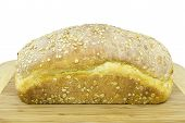 picture of home-made bread  - Big loaf of a home made bread on a wooden board - JPG
