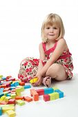 4 Year Old Girl Playing With Blocks