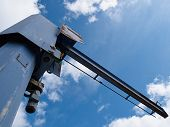 stock photo of boom-truck  - Industrial Crane operating with blue sky in the background - JPG