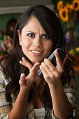 Frustrated Latina Woman On Phone