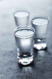 image of vodka  - Shot glasses of cold vodka - JPG