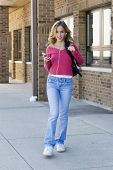 picture of teenage girl  - Model Release 291 Teenage girl listening to music at school - JPG