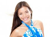 Beach summer woman in blue sarong isolated on white background. Beautiful mixed race Chinese Asian Caucasian female model smiling.