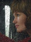 Girl Looks Thru Waterdropped Widow Glass 9