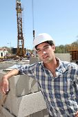 Construction worker standing on building site
