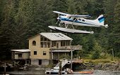 Seaplane Taking Off In Alaska Wilderness