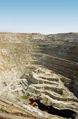 stock photo of ore lead  - Large deep pit with the railroad and trains in Kazakhstan - JPG