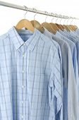 Dress shirts on wooden hangers