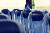 transport, tourism, road trip and equipment concept - travel bus interior and seats poster
