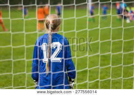 Girls Soccer Team Kicking Match