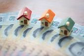 House Model On Banknotes, Saving Money For Real Estate Concept, House Model,  For Pay Loan,   Concep poster
