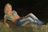 Blond Lady Lying On Bale