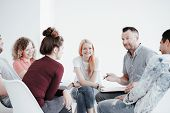 Group Of Teenagers During Psychotherapy With Professional Therapist poster