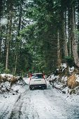 Suv Car With Chain On Wheels In Snowed Forest. Off Road Journey poster