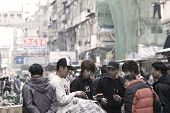 Busy Hawkers With Customers In Downtown Of Hong Kong