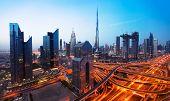 Dubai sunset panoramic view of downtown. Dubai is super modern city of UAE, cosmopolitan megalopolis poster