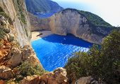 Beautiful View On Shipwreck Beach In Bay, Boats And Ships With Swimming People In Ionian Sea Blue Wa poster
