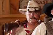 Old West Trapper With Pipe