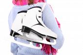 A picture of a pair of figure skates on the back of the woman