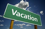 picture of sabbatical  - Vacation Road Sign on dramatic blue sky and cloud background - JPG