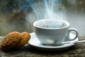 Coffee Time On Rainy Day. Fresh Brewed Coffee In White Cup Or Mug On Windowsill. Wet Glass Window An poster