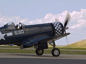 picture of f4  - F4 Corsair WWII fighter taxiing preparing for takeoff - JPG
